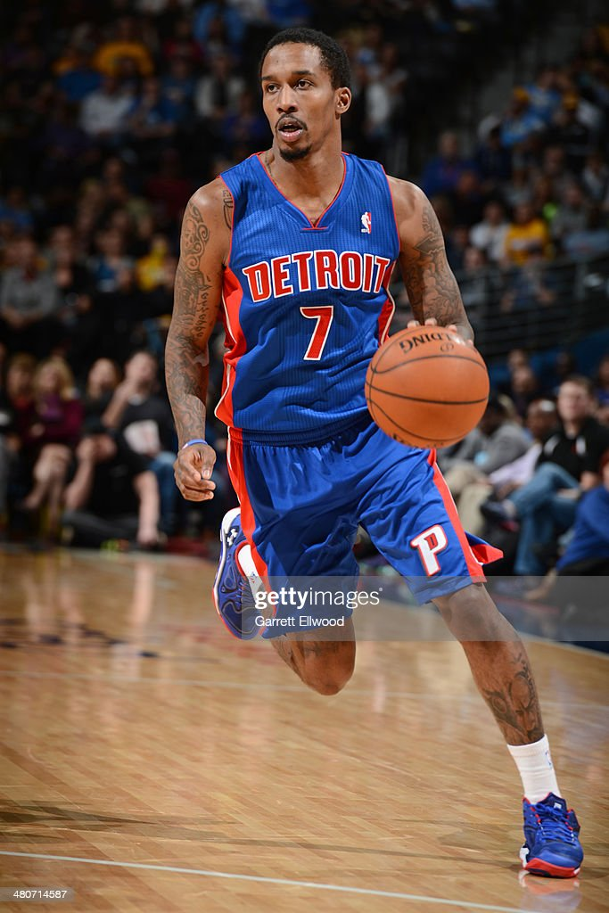Brandon Jennings #7 of the Detroit Pistons drives against the Denver Nuggets on March 19, 2014 at the Pepsi Center in Denver, Colorado.