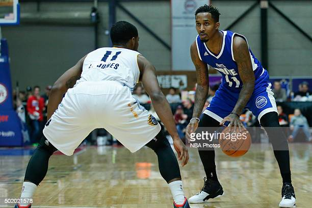 Brandon Jennings of the Grand Rapids Drive dribbles the ball against Lazeric Jones of the Iowa Energy during the first half of an NBA DLeague game on...
