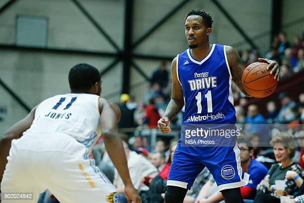 Brandon Jennings of the Grand Rapids Drive looks to pass the ball against Lazeric Jones of the Iowa Energy during the second half of an NBA DLeague...