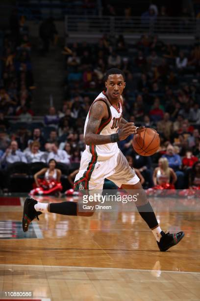 Brandon Jennings of the Milwakee Bucks moves the ball against the Sacramento Kings on on March 23 2011 at the Bradley Center in Milwaukee Wisconsin...