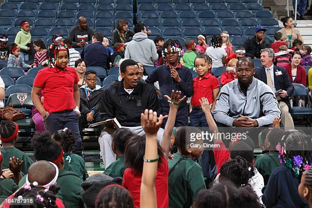 Brandon Jennings of the Milwaukee Bucks and assistant coach Anthony Goldwire read stories and answer questions during the Bucks and Sam's Hope...