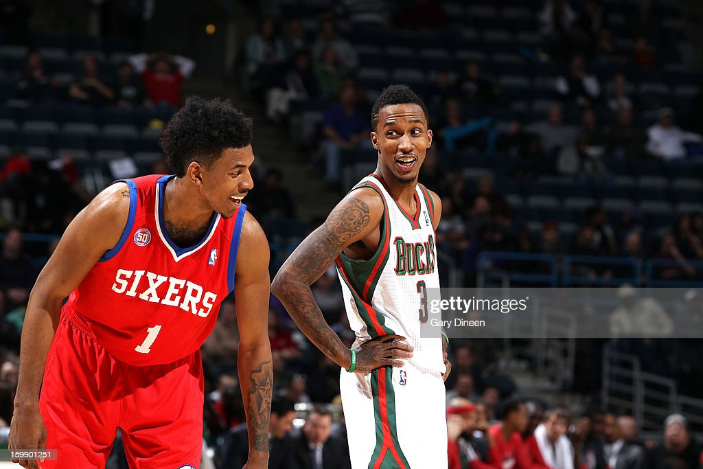 Brandon Jennings #3 of the Milwaukee Bucks and Nick Young #1 of the Philadelphia 76ers speak during the game on January 22, 2013 at the BMO Harris Bradley Center in Milwaukee, Wisconsin.