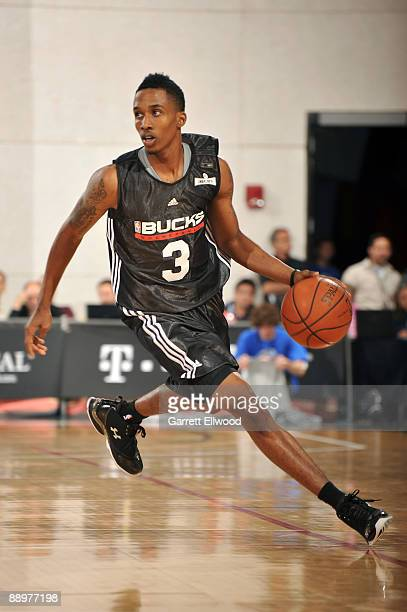 Brandon Jennings of the Milwaukee Bucks brings the ball up court during the game against the Dallas Mavericks during NBA Summer League presented by...