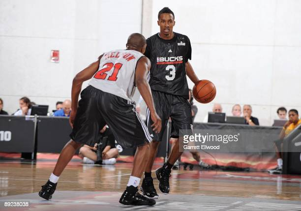 Brandon Jennings of the Milwaukee Bucks brings the ball upcourt against DeMarcus Nelson of the Chicago Bulls during NBA Summer League presented by EA...