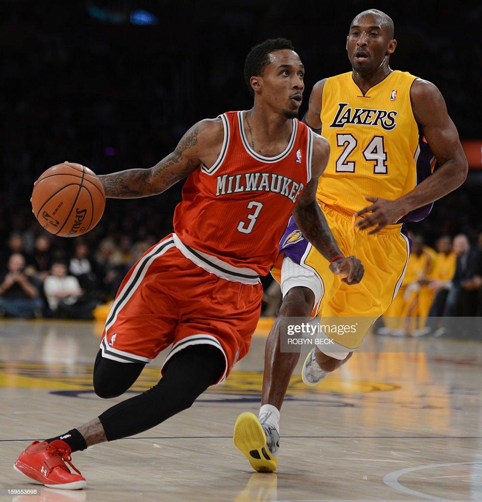 f5a17e72112 BASKET-US-NBA-LAKERS-BUCKS. Brandon Jennings (L) of the Milwaukee Bucks  drives past Kobe Bryant ...