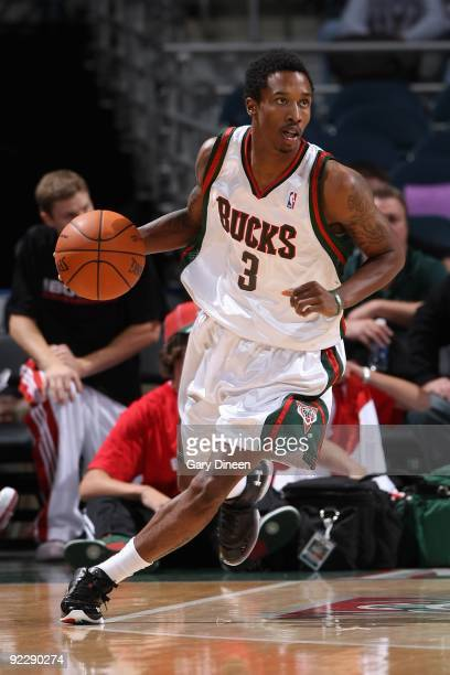 Brandon Jennings of the Milwaukee Bucks drives the ball upcourt against the Minnesota Timberwolves during the preseason game on October 17 2009 at...