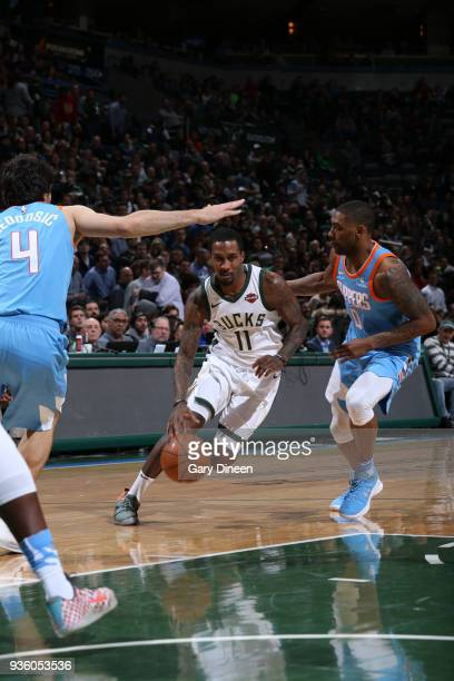 Brandon Jennings of the Milwaukee Bucks drives to the basket against Milos Teodosic and Sindarious Thornwell of the Los Angeles Clippers during the...
