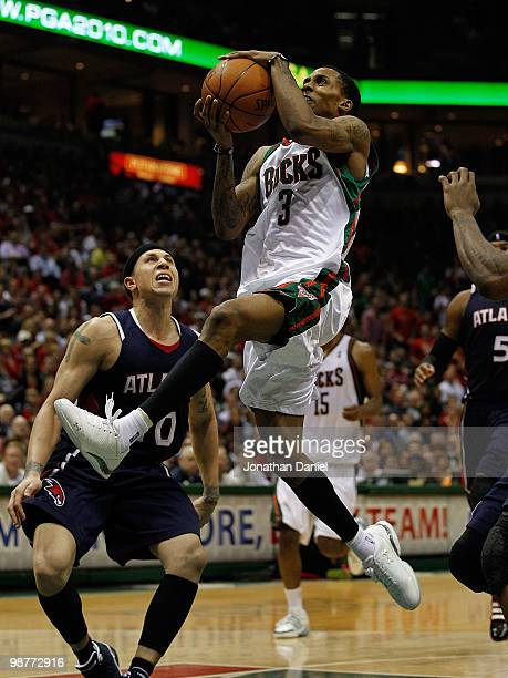 Brandon Jennings of the Milwaukee Bucks drives to the basket past Mike Bibby of the Atlanta Hawks in Game Six of the Eastern Conference Quarterfinals...