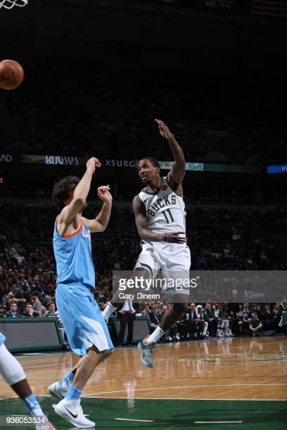 Brandon Jennings of the Milwaukee Bucks passes against Milos Teodosic of the Los Angeles Clippers during the NBA game on March 21 2018 at the BMO...