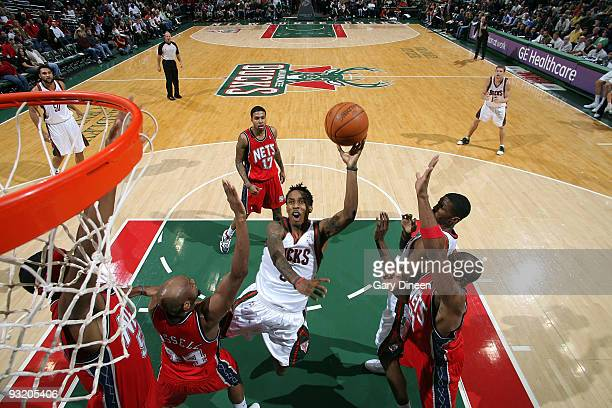 Brandon Jennings of the Milwaukee Bucks shoots a floater against Trenton Hassel of the New Jersey Nets on November 18 2009 at the Bradley Center in...
