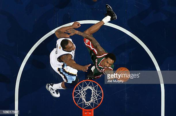 Brandon Jennings of the Milwaukee Bucks shoots against Darrell Arthur of the Memphis Grizzlies on February 11 2011 at FedExForum in Memphis Tennessee...
