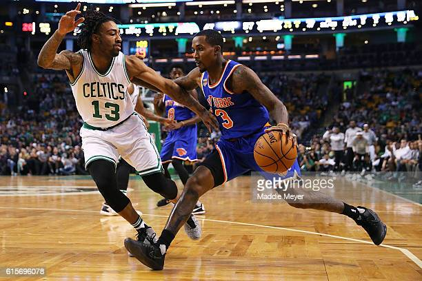 Brandon Jennings of the New York Knicks drives against James Young of the Boston Celtics during the second quarter at TD Garden on October 17 2016 in...
