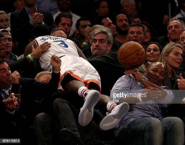 Brandon Jennings of the New York Knicks falls into the fans as he chases a loose ball in the second quarter against the Cleveland Cavaliers at...