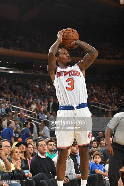 Brandon Jennings of the New York Knicks shoots the ball against the Brooklyn Nets in a preseason game at Madison Square Garden on October 8 2016 in...