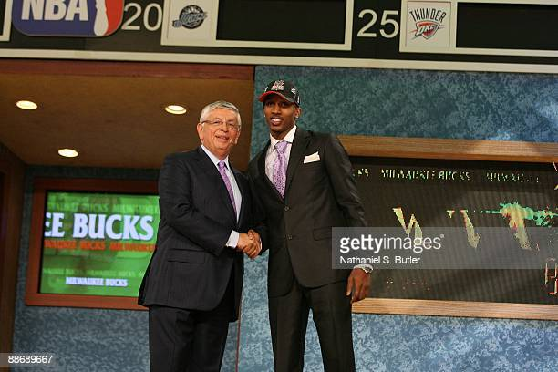 Brandon Jennings shakes hands with NBA Commissioner David Stern after being selected tenth by the Milwaukee Bucks during the 2009 NBA Draft on June...