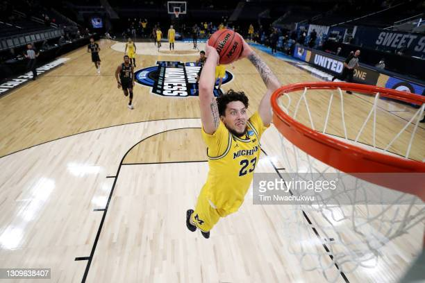 Brandon Johns Jr. #23 of the Michigan Wolverines dunks the ball against the Florida State Seminoles in the first half of their Sweet Sixteen round...