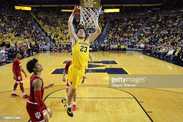Brandon Johns Jr #23 of the Michigan Wolverines gets to the basket for a dunk next to Juwan Morgan of the Indiana Hoosiers at Crisler Arena on...