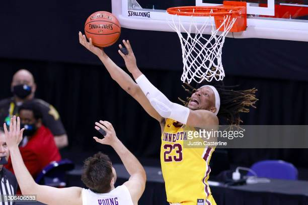 Brandon Johnson of the Minnesota Golden Gophers takes a shot while being guarded by Ryan Young of the Northwestern Wildcats during the second half in...