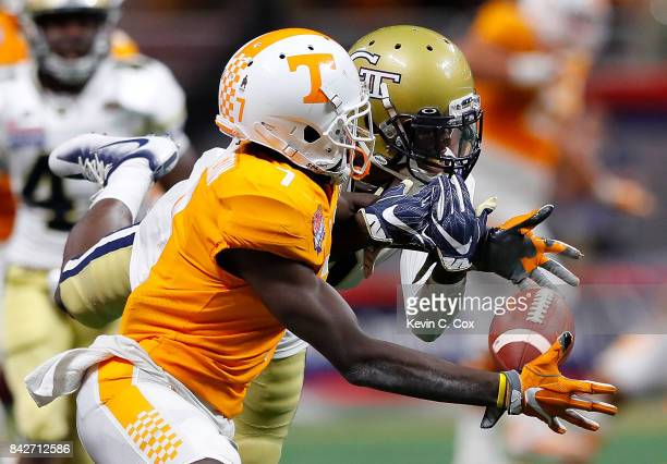 Brandon Johnson of the Tennessee Volunteers fails to pull in this reception against Step Durham of the Georgia Tech Yellow Jackets at MercedesBenz...