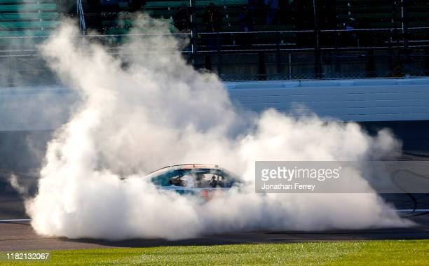 Brandon Jones, driver of the Flow Toyota, celebrates his victory with a burnout after winning the NASCAR Xfinity Series Kansas Lottery 300 at Kansas...