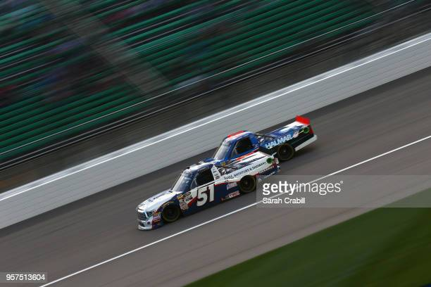 Brandon Jones driver of the Lyons Industries/Menards Toyota leads Stewart Friesen driver of the We Build America Chevrolet during the NASCAR Camping...