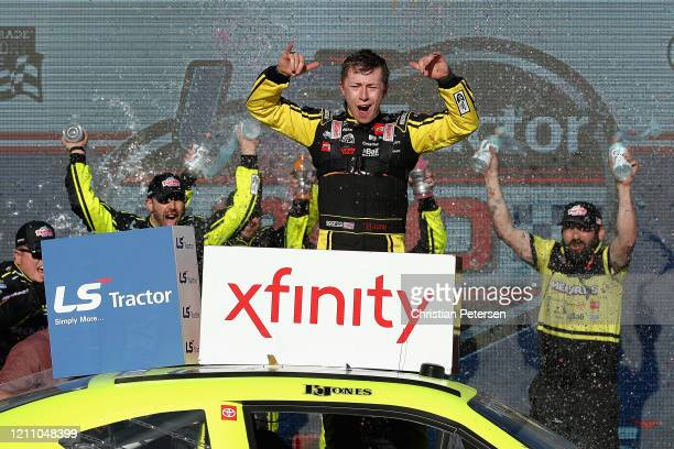 Brandon Jones, driver of the Menards/Turtle Wax Toyota, celebrates in victory lane after winning the NASCAR Xfinity Series LS Tractor 200 at Phoenix...