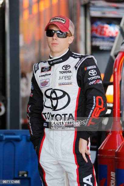 Brandon Jones driver of the SoleusAir/Menards Toyota stands in the garage area prior to practice for the NASCAR Camping World Truck Series Buckle Up...