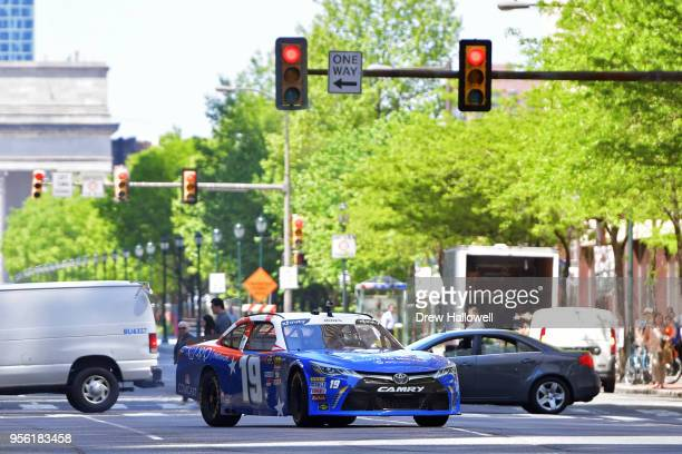 Brandon Jones driver of the XYO Networks Toyota slides his car across JFK Boulavard as fans take photos during the 3rd Annual NASCAR Xfinity...
