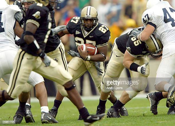 Brandon Jones of Purdue Boilermakers runs with the ball against Penn State during the 2814 victory over Penn State Nitinay Lions on October 11 2003...
