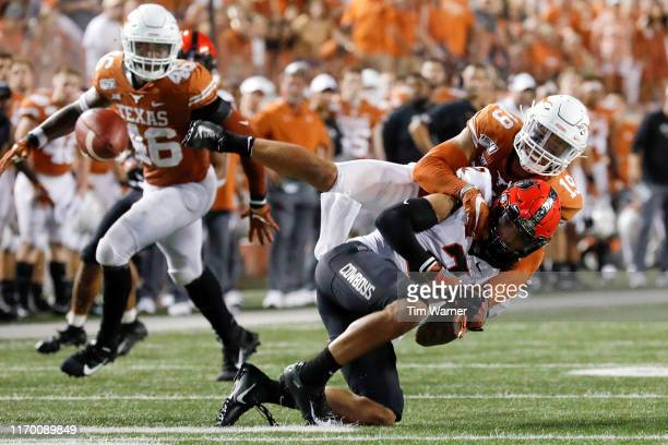 Brandon Jones of the Texas Longhorns breaks up a pass intended for Tylan Wallace of the Oklahoma State Cowboys in the second half at Darrell K...
