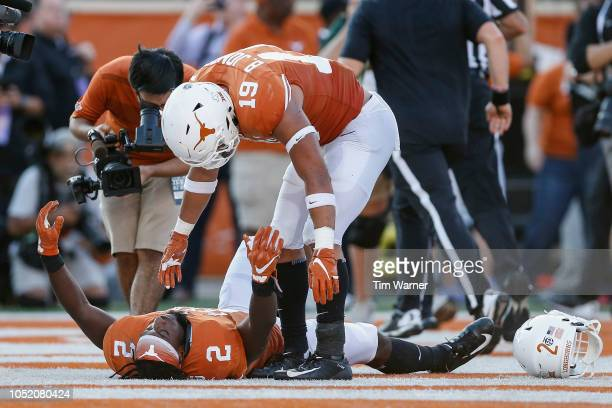 Brandon Jones of the Texas Longhorns celebrates with Kris Boyd after the game against the Baylor Bears at Darrell K RoyalTexas Memorial Stadium on...