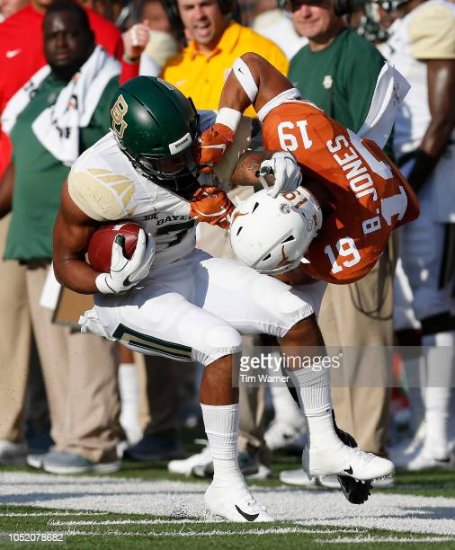 Brandon Jones of the Texas Longhorns tackles John Lovett of the Baylor Bears by the facemask in the second half at Darrell K Royal-Texas Memorial...