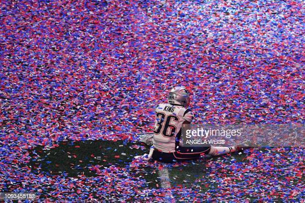 Brandon King of the New England Patriots sits in confetti on the pitch after winning Super Bowl LIII against the Los Angeles Rams at Mercedes-Benz...