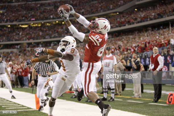 Brandon Kinnie of the Nebraska Cornhuskers leaps for the catch against Chykie Brown of the Texas Longhorns during Big 12 Football Championship game...