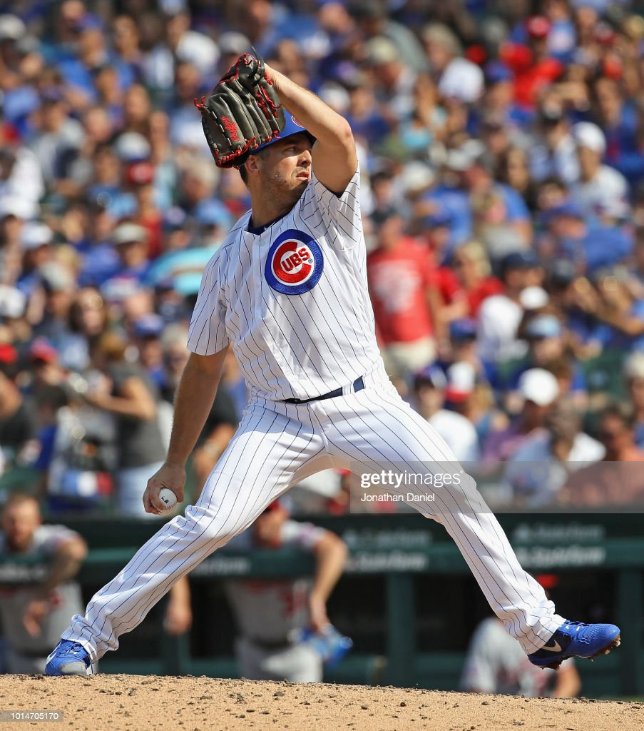 Brandon Kintzler #20 of the Chicago Cubs pitches in the 8th inning against the Washington Nationals at Wrigley Field on August 10, 2018 in Chicago, Illinois. The Cubs defeated the Nationals 3-2.