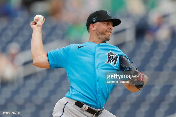 Brandon Kintzler of the Miami Marlins delivers a pitch in the third inning against the Houston Astros during a Grapefruit League spring training game...