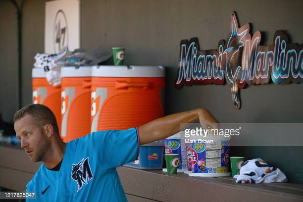 Brandon Kintzler of the Miami Marlins reaches for Double Bubble Gum in the dugout during the spring training game against the St. Louis Cardinals at...