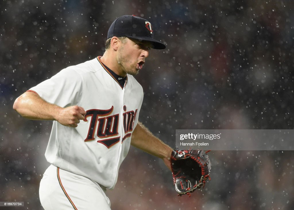 Brandon Kintzler #27 of the Minnesota Twins celebrates winning the game against the New York Yankees as rain falls on July 17, 2017 at Target Field in Minneapolis, Minnesota. The Twins defeated the Yankees 4-2.