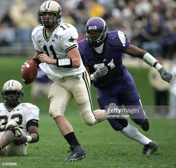 Brandon Kirsch of Purdue is chased by John Pickens of Northwestern on October 30 2004 at Ryan Field at Northwestern University in Evanston Illinois...