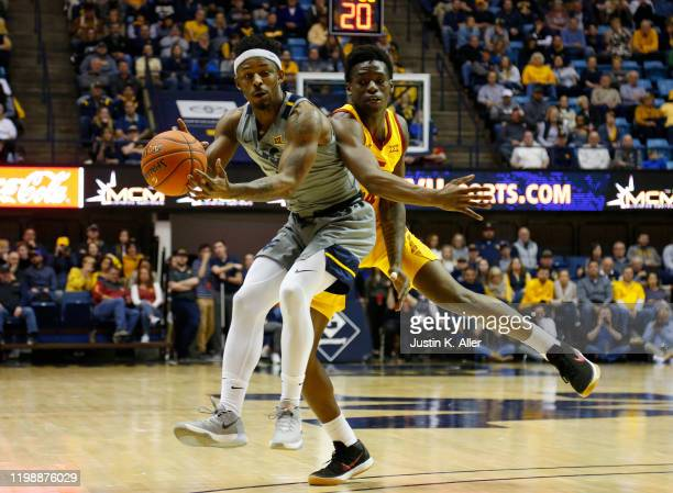 Brandon Knapper of the West Virginia Mountaineers and Nate Jenkins of the Iowa State Cyclones battle for the ball at the WVU Coliseum on February 5...