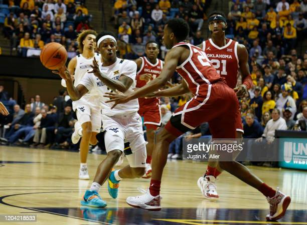 Brandon Knapper of the West Virginia Mountaineers makes a pass against the Oklahoma Sooners at the WVU Coliseum on February 29 2020 in Morgantown...