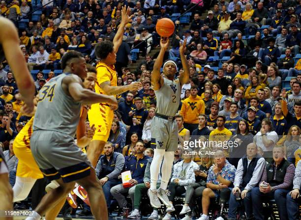 Brandon Knapper of the West Virginia Mountaineers pulls up for a three against the Iowa State Cyclones at the WVU Coliseum on February 5 2020 in...