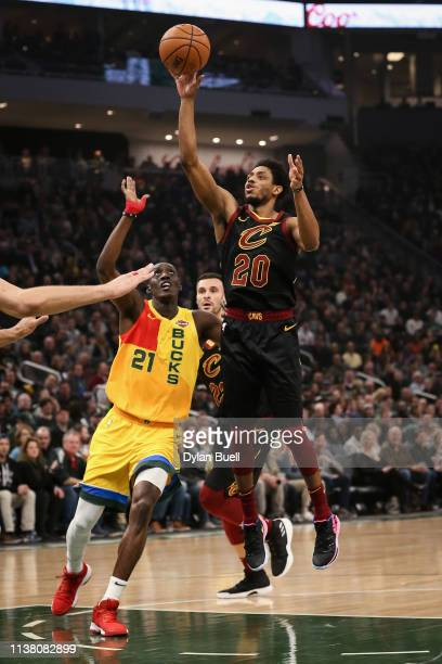 Brandon Knight of the Cleveland Cavaliers attempts a shot while being guarded by Tony Snell of the Milwaukee Bucks in the first quarter at the Fiserv...