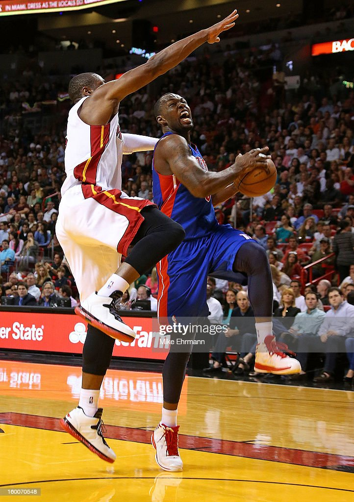 Brandon Knight #7 of the Detroit Pistons drives against Dwyane Wade #3 of the Miami Heat during a game at American Airlines Arena on January 25, 2013 in Miami, Florida.