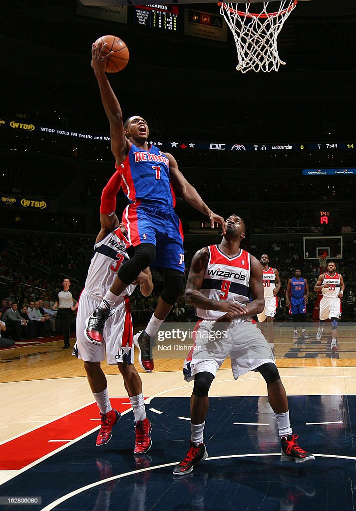 Brandon Knight #7 of the Detroit Pistons goes to the basket against Bradley Beal #3 and Martell Webster #9 of the Washington Wizards during the game at the Verizon Center on February 27, 2013 in Washington, DC.