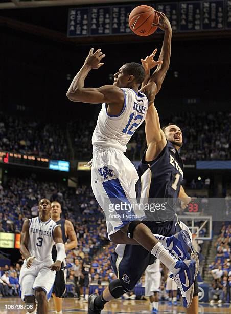 Brandon Knight of the Kentucky Wildcats shoots the ball while defended by Mike Smith of the East Tennessee State Buccaneers during the game at Rupp...