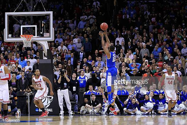 Brandon Knight of the Kentucky Wildcats shoots the winning shot to defeat the Ohio State Buckeyes in the east regional semifinal of the 2011 NCAA...