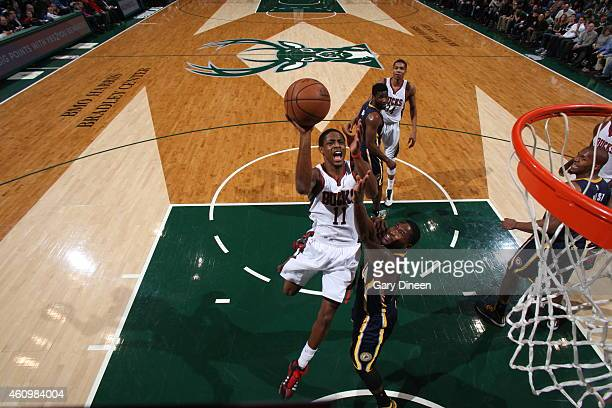 Brandon Knight of the Milwaukee Bucks goes to the basket against the Indiana Pacers on January 2 2015 at the BMO Harris Bradley Center in Milwaukee...