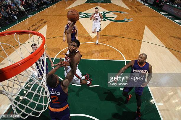 Brandon Knight of the Milwaukee Bucks goes up for a dunk against the Phoenix Suns on January 6 2015 at the BMO Harris Bradley Center in Milwaukee...