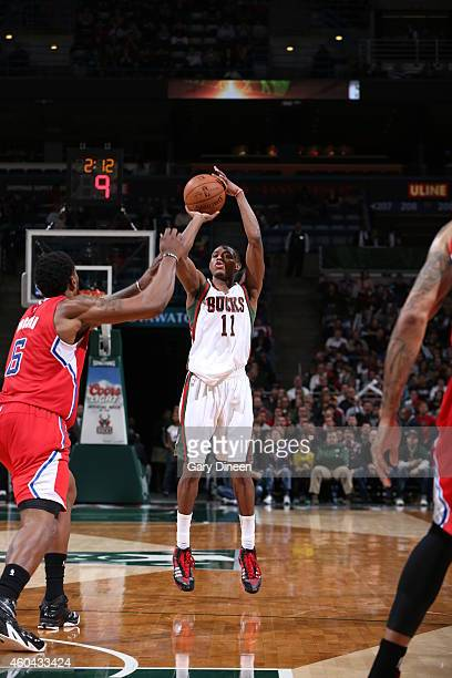 Brandon Knight of the Milwaukee Bucks shoots against DeAndre Jordan of the Los Angeles Clippers on December 13 2014 at the BMO Harris Bradley Center...